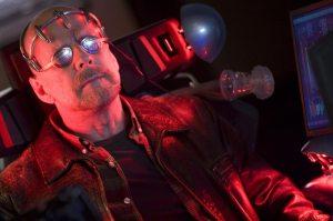 Bruce Willis as Greer