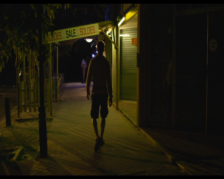 Neon-drenched street, long shadows... all very Nicolas Winding-Refn